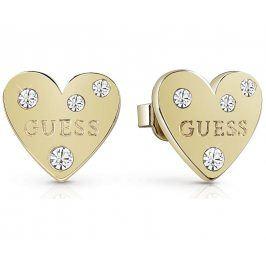 Guess Pozlacené srdíčkové náušnice s krystaly UBE84004
